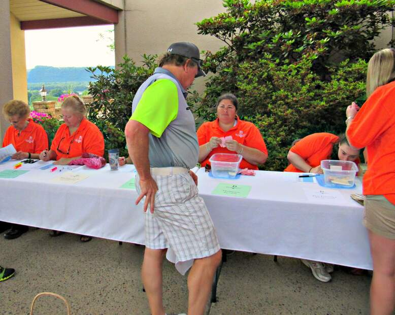 event organizers in orange polo shirts