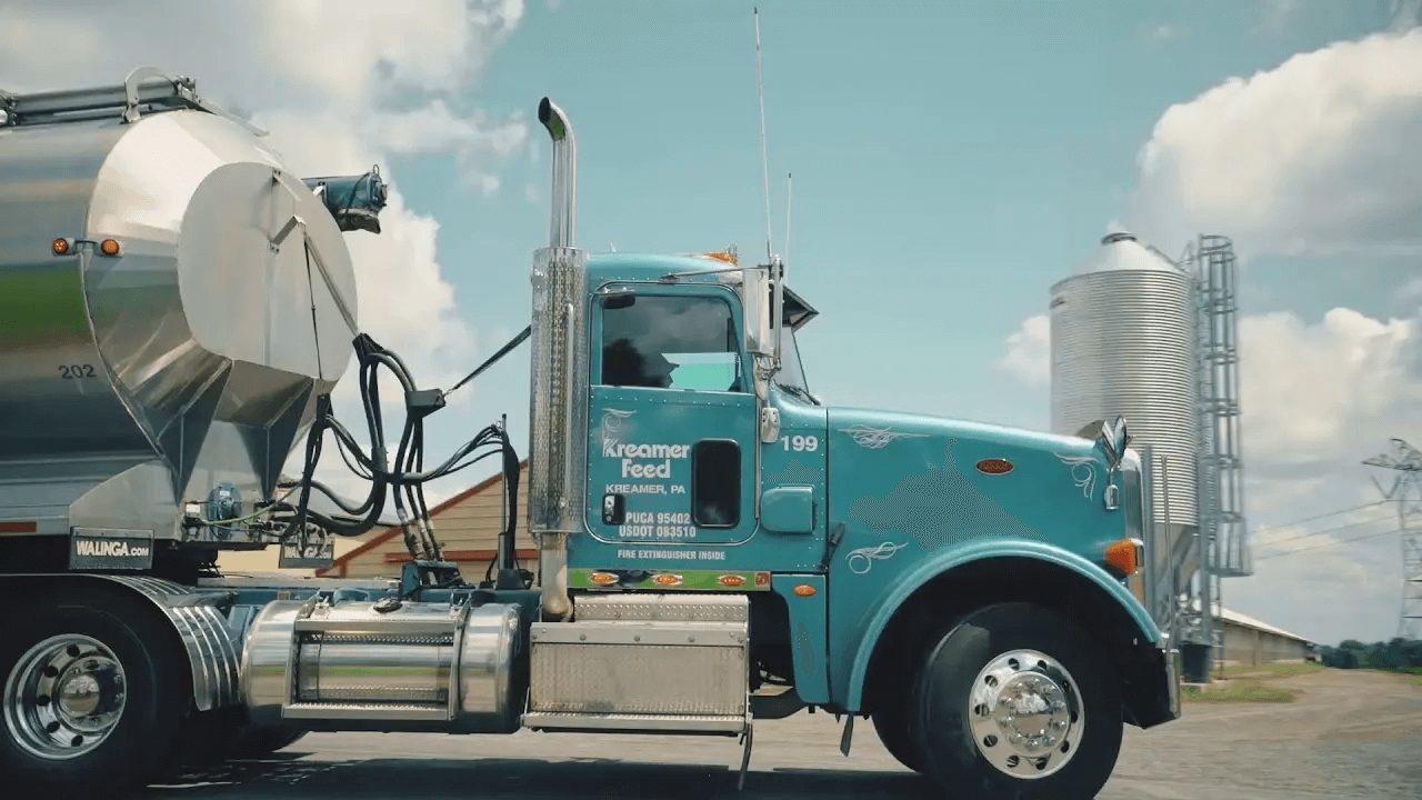 blue truck hauling organic animal feed